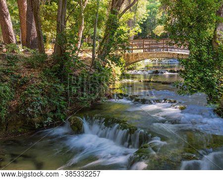 A Beautiful Small Stream With The River Rapids. Stone Bridge. Krka National Park, Croatia.