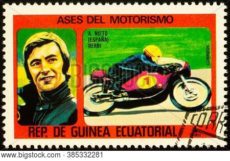 Moscow, Russia - September 14, 2020: Stamp Printed In Equatorial Guinea Shows Racing Motorcyclist An