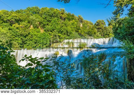 Cascade Waterfalls In The Forest. Sunny Day. Krka National Park, Croatia.