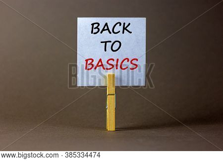 White Paper With Text 'back To Basics', Clip On Wood Clothespin. Beautiful Grey Background. Business