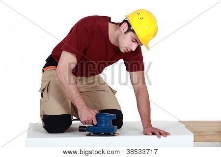 Man using a sander