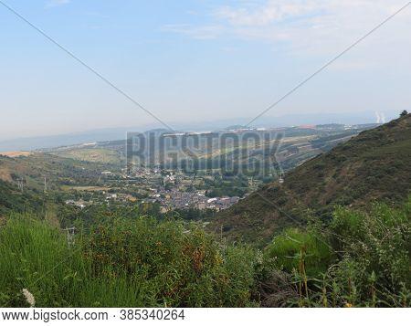 View Of A Village From Montes De Leon, Spain, On Camino De Santiago Pilgrimage Route