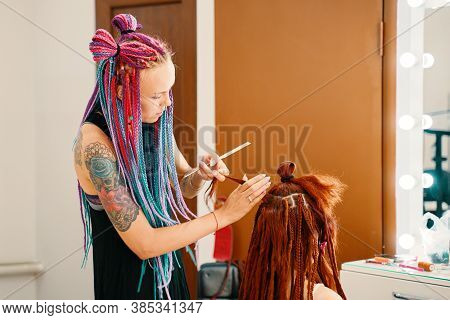 Barber Braids Dreadlocks. Girl Head With Braids From The Material, Creative Hairstyle With Thick Pla