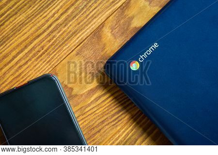 Blue Asus Chromebook And Iphone On A Wooden Table, Top View. Bishkek, Kyrgyzstan - June 8, 2019.