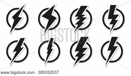 Set Of Black Lightning Bolt Icons. Electrical Strike Sign Sticker In Circle. Design Logo Voltage Pow