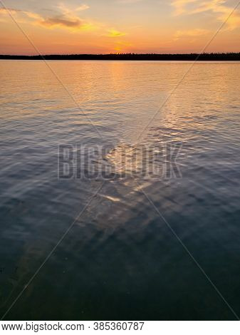 Sunset Over Calm Water On Child's Lake In Duck Mountain Provincial Park, Manitoba, Canada