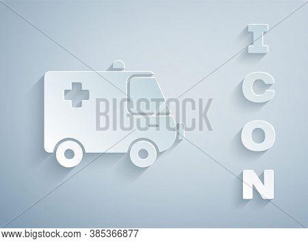 Paper Cut Ambulance And Emergency Car Icon Isolated On Grey Background. Ambulance Vehicle Medical Ev