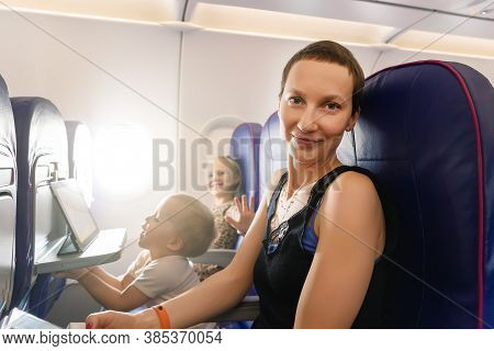 Young Adult Beautiful Attractive Caucasian Mother Traveling With Cute Little Adorable Sibling Boy An