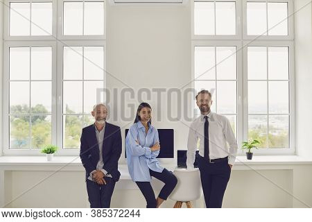 Happy Members Of Diverse Company Staff Gather Together In Modern Spacious Office