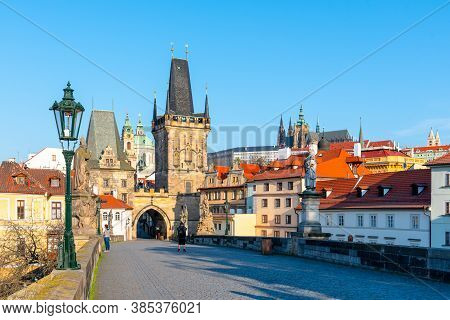 Morning On Charles Bridge, Czech: Karluv Most. View Of Lesser Town Bridge Tower And Prague Castle. P