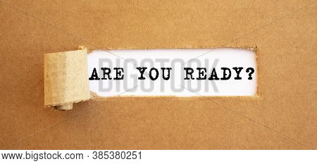 Text Are You Ready Appearing Behind Torn Brown Paper.