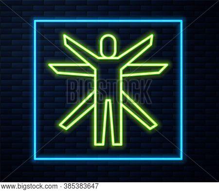 Glowing Neon Line Vitruvian Man By Leonardo Da Vinci Icon Isolated On Brick Wall Background. Human A