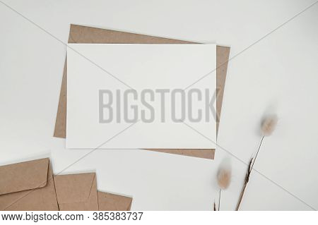 Blank White Paper On Brown Paper Envelope With Rabbit Tail Dry Flower. Mock-up Of Horizontal Blank G