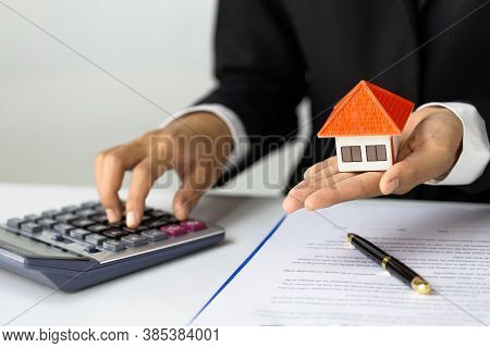 Hands Holding A  House Model. Housing Industry Mortgage Plan And Residential Tax Saving Strategy, Mo