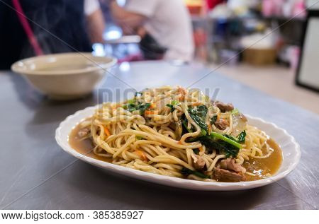 eat famous Taiwanese fried noodles at a restaurant