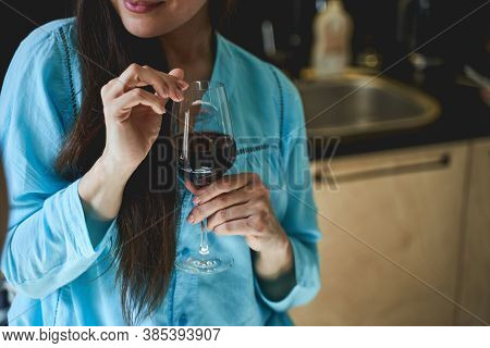 Dark-haired Woman Holding A Wineglass In Her Hand