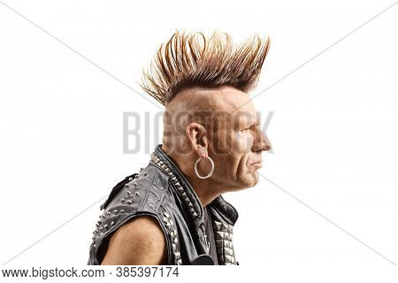 Profile shot of a middle aged punker with a mohawk isolated on white background