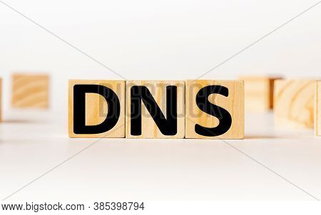 A Wooden Block With The Word Dns Domain Name System Written On It On A White Background. Business Co
