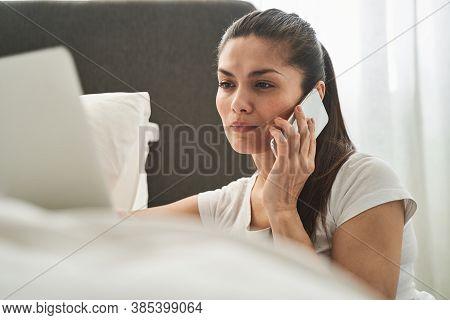 Attentive Female Telecommuter Having A Phone Conversation