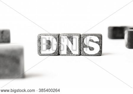 Three Stone Cubes Inscribed With The Word Dns Domain Name System Among The Cubes On A White Backgrou