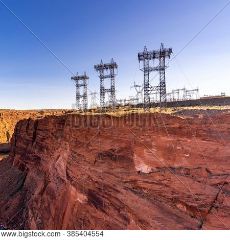 Power plant house and power line over Electricity generating dam with river colorado in Page Arizona USA