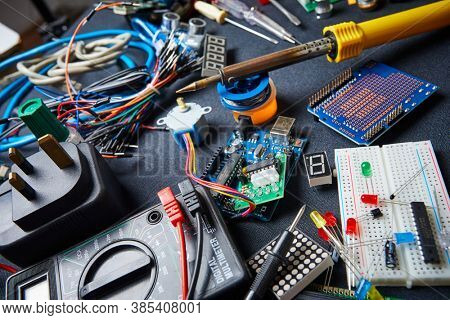electronic board and tools repairs on black background
