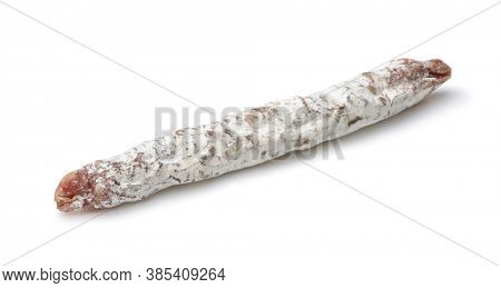 Catalan thin dry cured pork sausage Fuet isolated on white