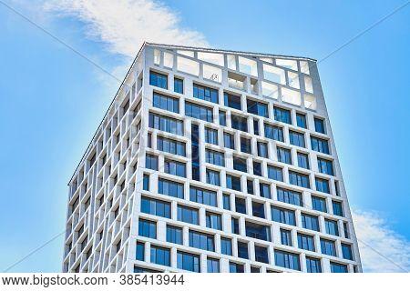Exterior Of Modern Multistory Building Against Blue Sky