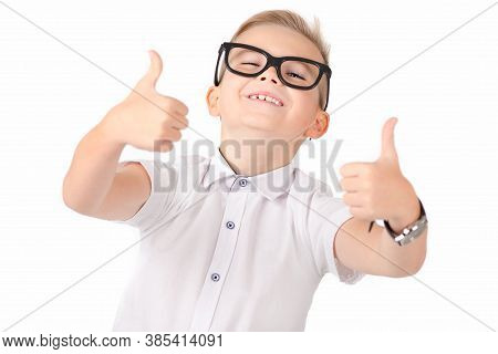 Close Up Portrait Of Atractive Elementary School Student Showing His Thumbs Up On Isolated White Bac