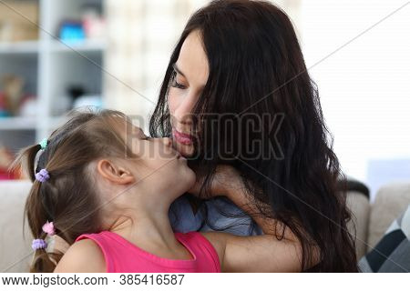 Portrait Of Caring Mommy And Glad Child Enjoying Spending Funny Time Together At Home. Lovely Mother