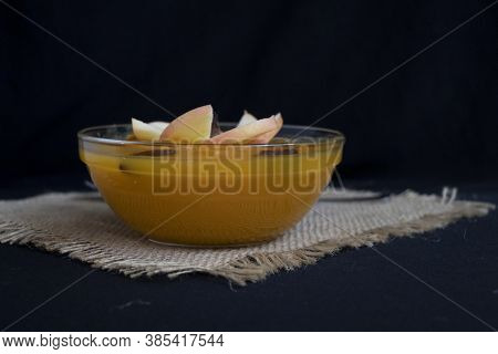 Delicious Pumpkin Puree With Apples And Raisins. Delicious Autumn Dish In A Glass Bowl On A Black Ba
