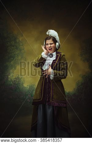 Music With Headphones. Modern Trendy Look, Portrait Of Renaissance Period Beautiful Woman. Retro Sty