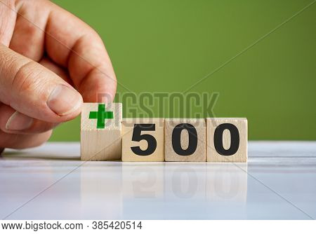 The Hand Turn Wooden Block With Plus Sign And Set Text