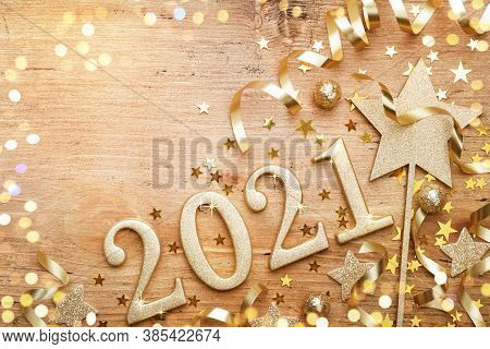 New Year Celebration And Festive Background With Golden Numbers 2021, Confetti Stars And Christmas D
