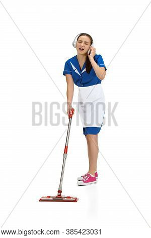 Working With Music, Headphones. Portrait Of Female Made, Housemaid, Cleaning Worker In White And Blu
