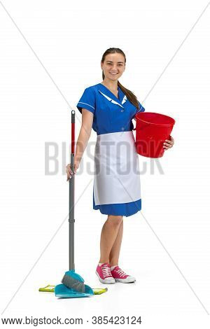 Using Equipments. Portrait Of Female Made, Housemaid, Cleaning Worker In White And Blue Uniform Isol