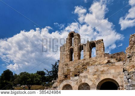 View Of Odeon Of Herodes Atticus Theater On Acropolis Hill, Athens, Greece, At Bright Blue Sky And S