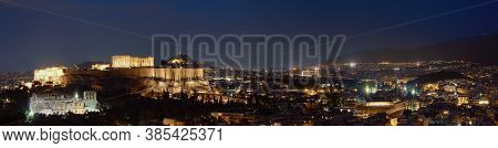 Iconic View Of Acropolis Hill In Athens, Greece At Night. Delicate Lights Of Parthenon And Odeon The