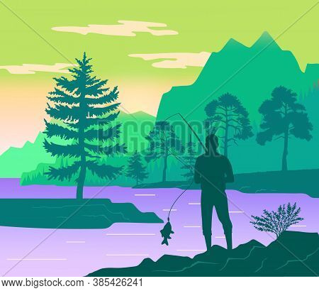 Fisherman With A Fishing Rod On The Shore Of A Forest River. Silhouette Of A Man Standing On Coast.