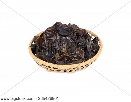 Fresh Black Jew's Ear Mushrooms In Bamboo Basket On White Background