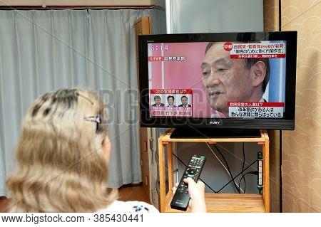 Fuji City, Shizuoka, Japan - September 14, 2020: Woman Watching The Press Conference Live Broadcast