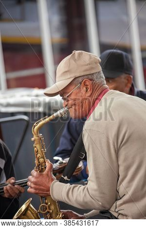 Cape Town, South Africa, 8.26.2012, old cape Malay musician playing the saxophone