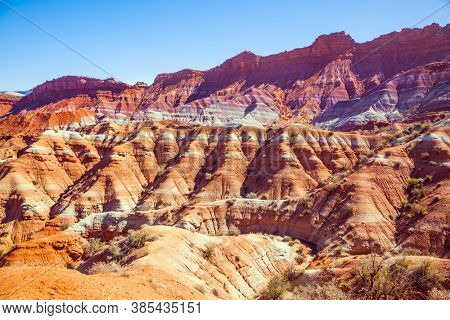 Paria Canyon-Vermilion Cliffs Wilderness Area. Huge slopes of red sandstone, striped from various inclusions of light rocks. Arizona and Utah, USA. The concept of active, extreme and photo tourism