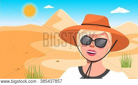 Young Happy Woman In Hat, Sunglasses Against The Background Of A Sand Dune In The Desert Sunny Day.