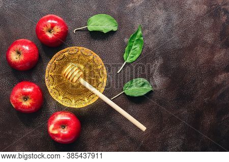 Apples And Honey On A Dark Rustic Background. Jewish New Year - Rosh Hashanah. Traditional Jewish Fo