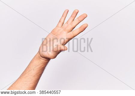 Close up of hand of young caucasian man over isolated background presenting with open palm, reaching for support and help, assistance gesture