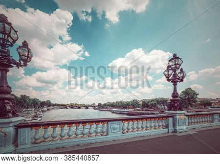 White Clouds Over Alexander Iii Bridge Over Seine River In Paris, France
