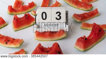 Wooden Calendar And Watermelon Rind. 03 August, National Watermelon Day. Lot Of Watermelon Eaten.