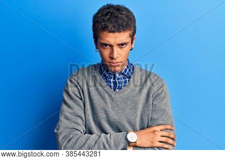 Young african amercian man wearing casual clothes skeptic and nervous, disapproving expression on face with crossed arms. negative person.