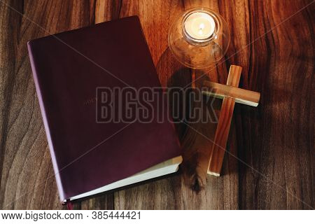 Bible And Crucifix Candlelight Provides Light For Bible Study, Christian Religious Concepts, The Cru